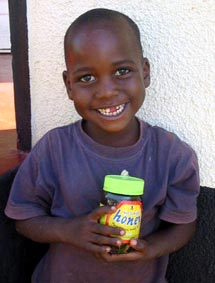 Young boy with honey